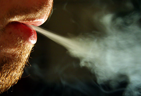 getty_rf_photo_of_man_exhaling_cigarette_smoke_closeup